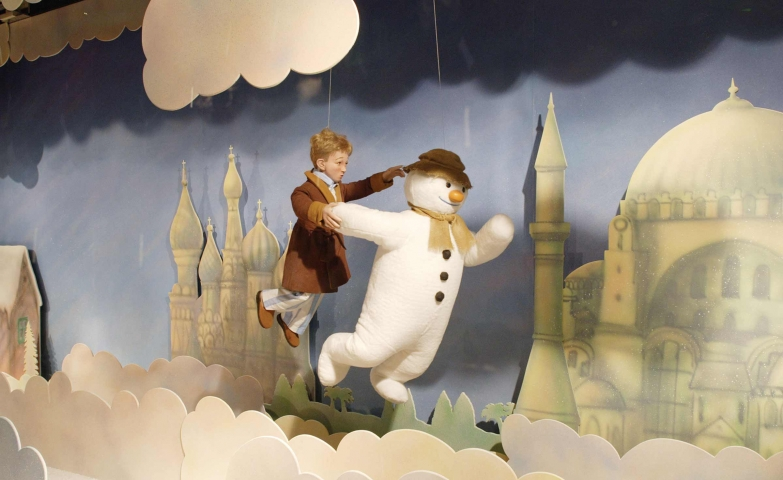 It may be a child's dream, following through clouds a snowman, but it's just a Christmas window display.