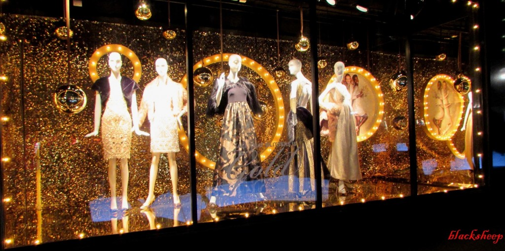 The golden balls, the sparkly background, and the sparkly lights are showing us through this window display that New Year's Eve is around the corner.