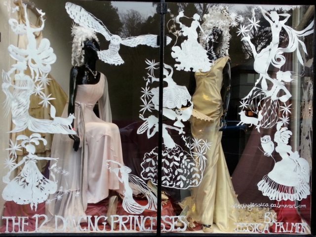 Clean, white stickers in this window display and beautiful dresses for the special night of Valentine's Day.