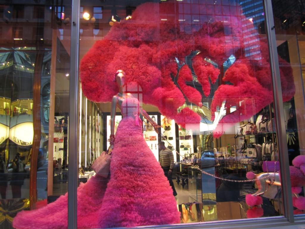 In this Valentine's day window display, we have a fabulous pink dress and a tree with a crown that looks like it's made from the same fabric as the dress.
