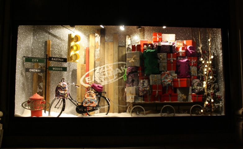 Wow! So many gifts in different colors, packaging and foam snow everywhere, in this Christmas window display.