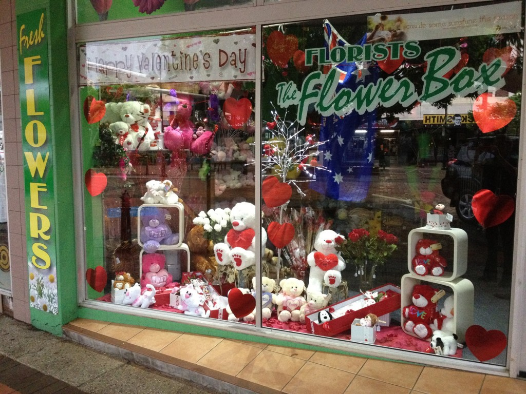 The FLower Box decorated the window display for Valentine's day occasion with many teddy bears, holding red plush hearts and hearts stickers.