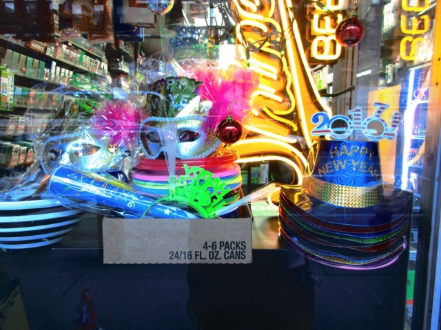 At Hell's Kitchen Brewtique, you can find party gifts, party hats, and masks, all placed in the window display to know better from where you can buy your New Year's Eve stuff.