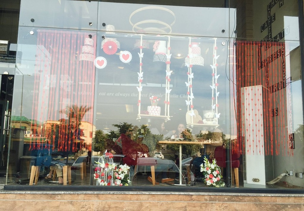 Like a daydream, this window display was decorated for Valentine's day with swings and flowerpots, hearts and flowers.