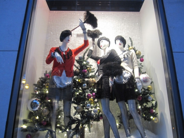 High-end and luxurious window display with abigails mannequins celebrating the New Year's Eve.
