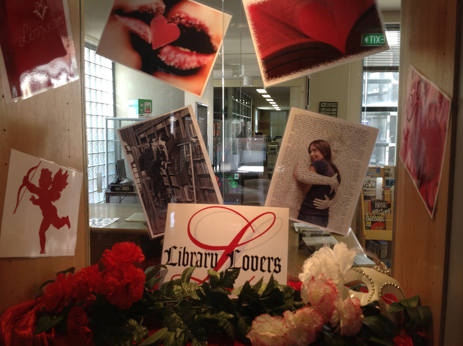 This old-fashioned Valentine's day window display is decorated with flowers and big printed pictures.