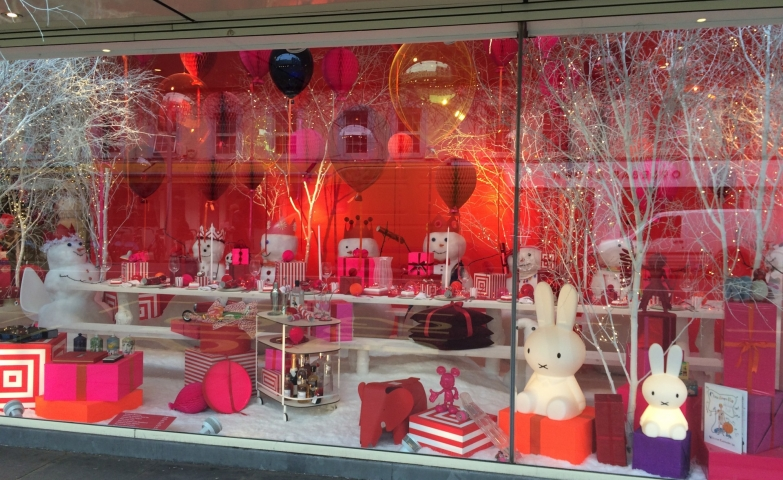 Great use of colors, good using of lights and funny white toys for the Christmas window display.