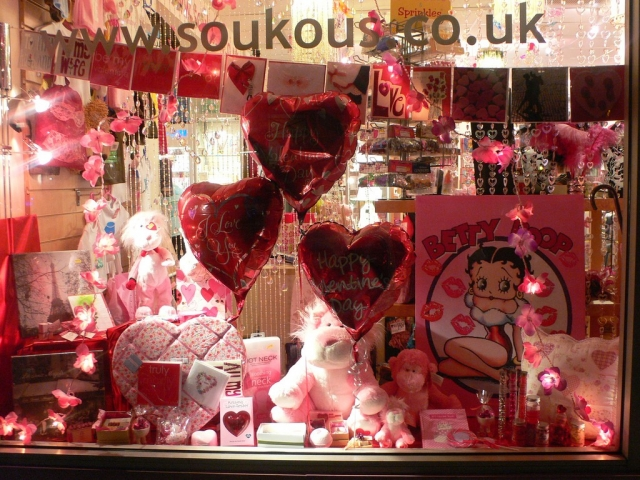 A full window display with pink objects, Betty Boop, hearts, cards, and other things that describe the best Valentine's day romance.