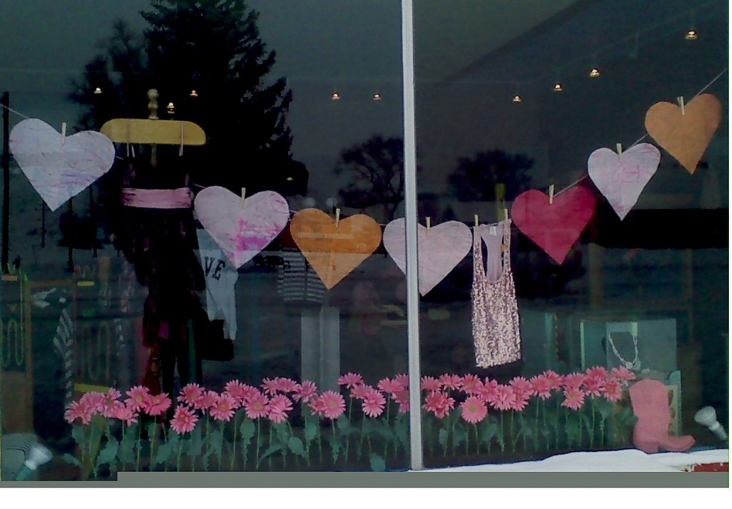 In this window display we have found a very beautiful little garden, but instead of laying the clothes on the string, we have hearts for Valentines'Day.