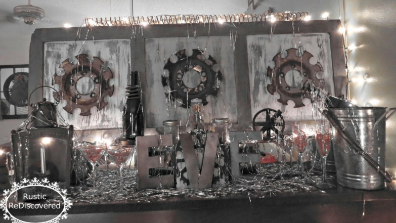 This New Year's Eve window display is looking industrial with a touch of silvery on candles, champagne buckets and on the other details.