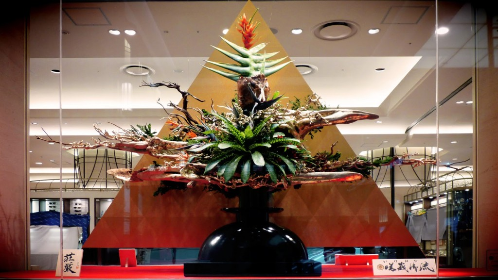 Another Japanese style window display, celebrating New Year's Eve with a triangle background and many plants.