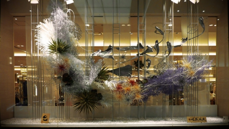 In Japan, the New Year's Eve is the most important celebration. Not sure what does that decoration means, but it looks pretty nice for a window display decoration.