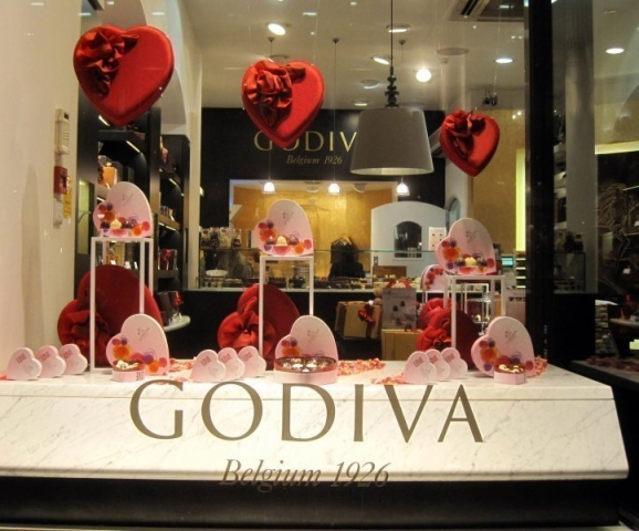 At Godiva, the elegant packages, in a heart shape, decorated for Valentine's Day, are beautifying the window display.