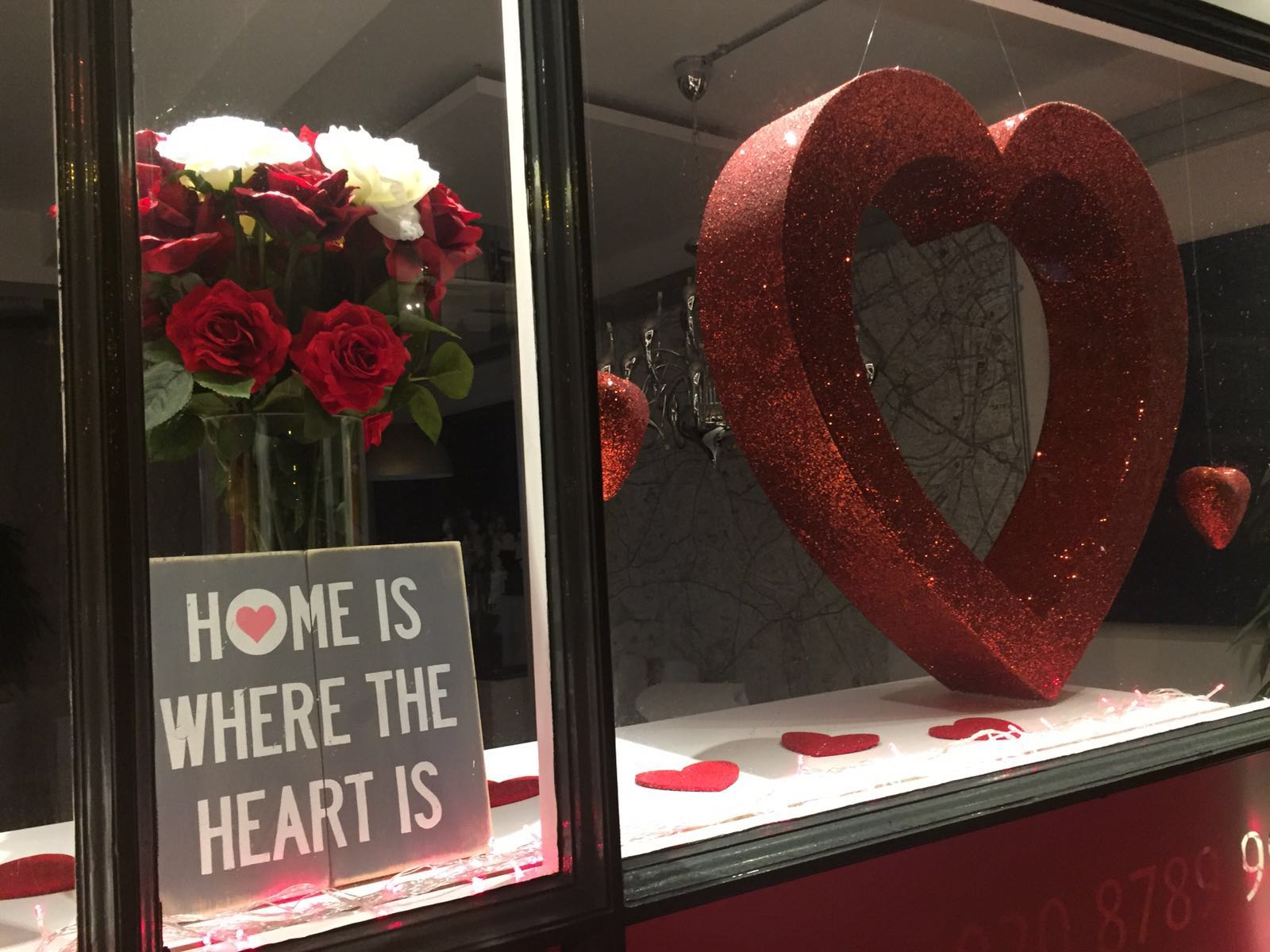 Do you know where your heart is? Because where your heart is, there is your home. Also, don't forget to add roses. That's what this window display is saying through Valentine's day decoration.