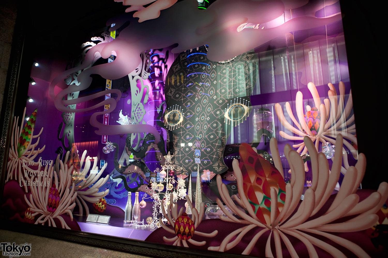 Isetan Shinjuku Christmas window display, it is looking like it has an underwater world, mostly purple.