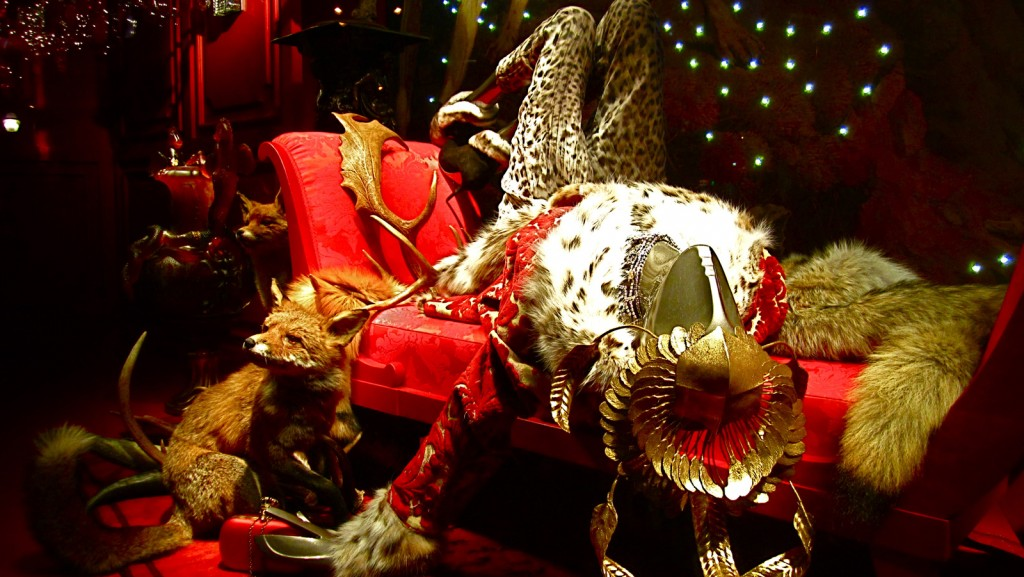 For this new year's eve window display, we have a mannequin sitting in an awkward position, surrounded by many red, lights and a fox.
