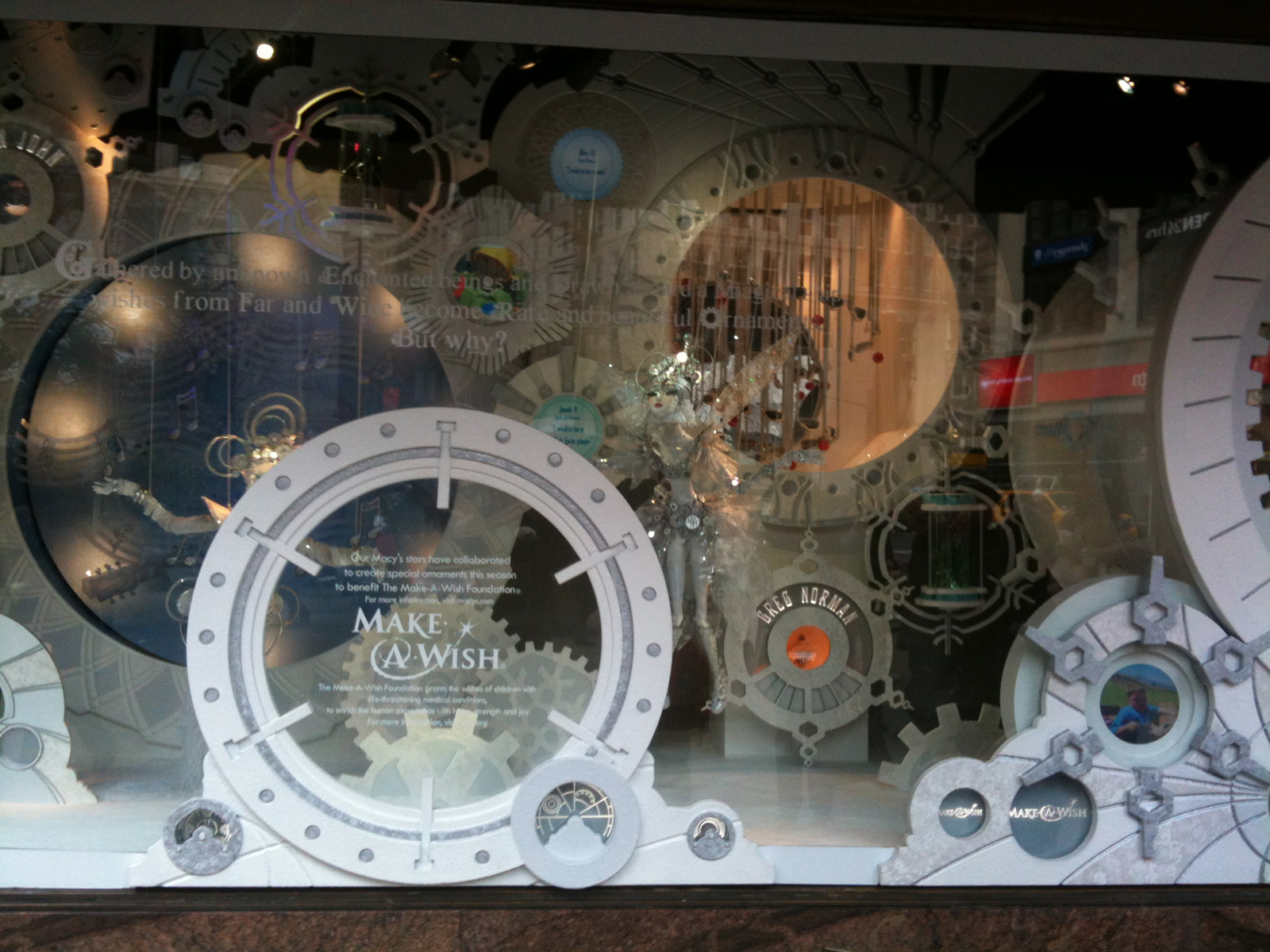 "Using a white and clean color scheme, Macy's has a spectacular ""Make a Wish"" mechanism for the Christmas window display."