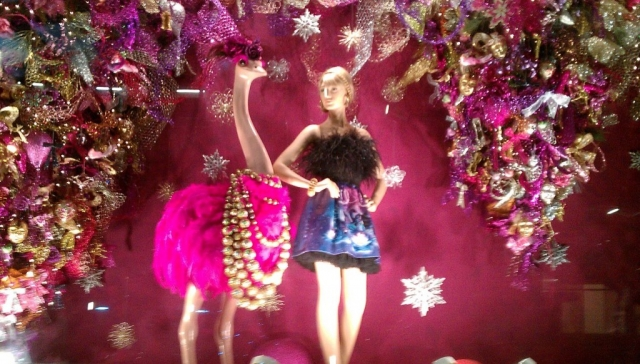 What is standing out in this New Year's Eve window display is the ostrich with pink feathers and with beads, and then the decoration around.