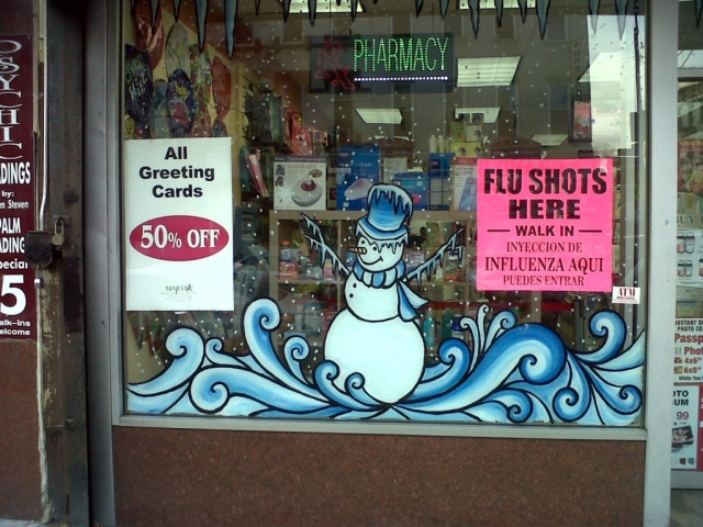 In this pharmacy, you will find 50% discount for the New Year's Eve greeting cards, and a cool snowman sticker on the window display.