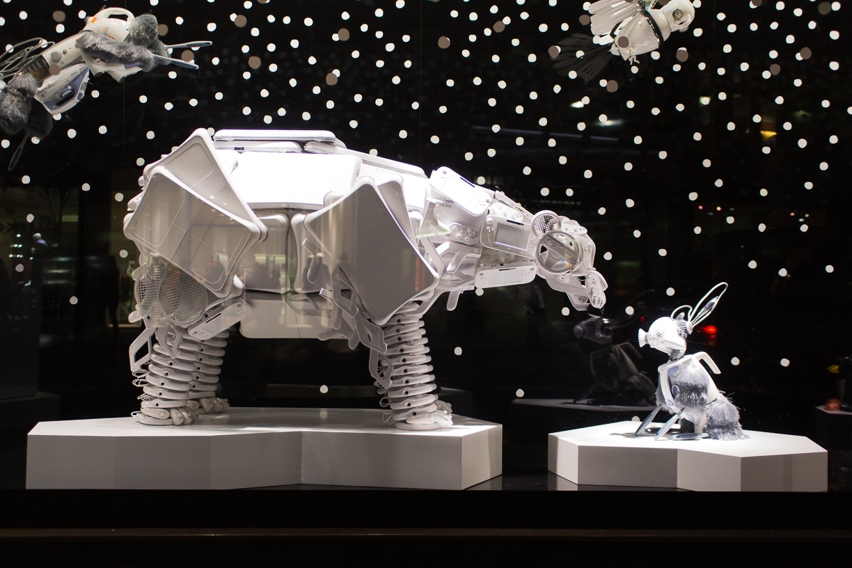 Such an amazing minimalist Christmas window display, represented simple and clean by two white constructions of a polar bear sniffing a bunny.
