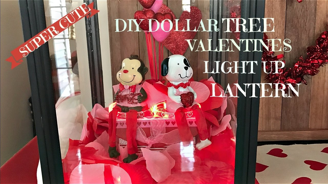 A monkey and a puppy, staying on a pink bench and giving a cute air to this Valentine's Day window display.