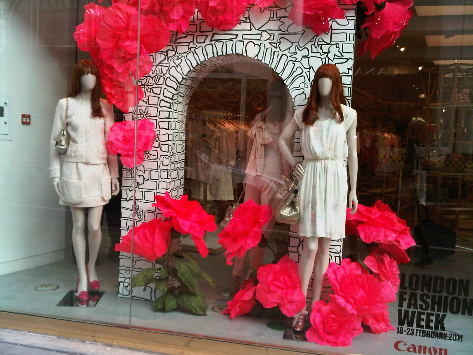 Mulberry is focused for Valentine's day, to decorate the window display with a secret garden theme, with pink, big flowers.