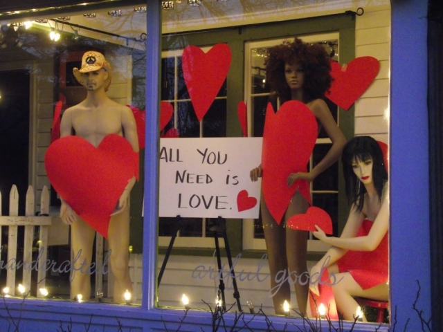 A store which chooses love instead of clothes for Valentine's day, and we could observe this in the window display by the fact that the mannequins are covered only with big red hearts.