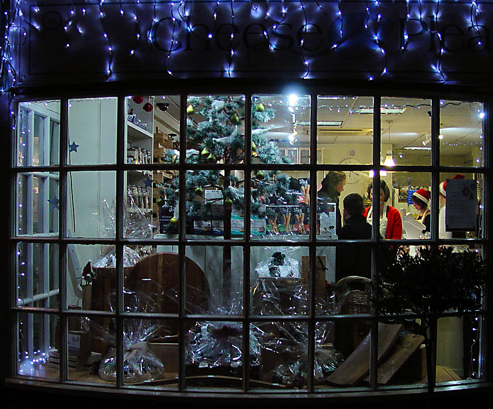 Only a few packed cookies and blue lights inside the Christmas window display.
