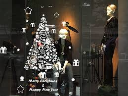 A window display decorated with a removable sticker with Merry Christmas messages and happy new year wishes, perfect also for the New Year's Eve.