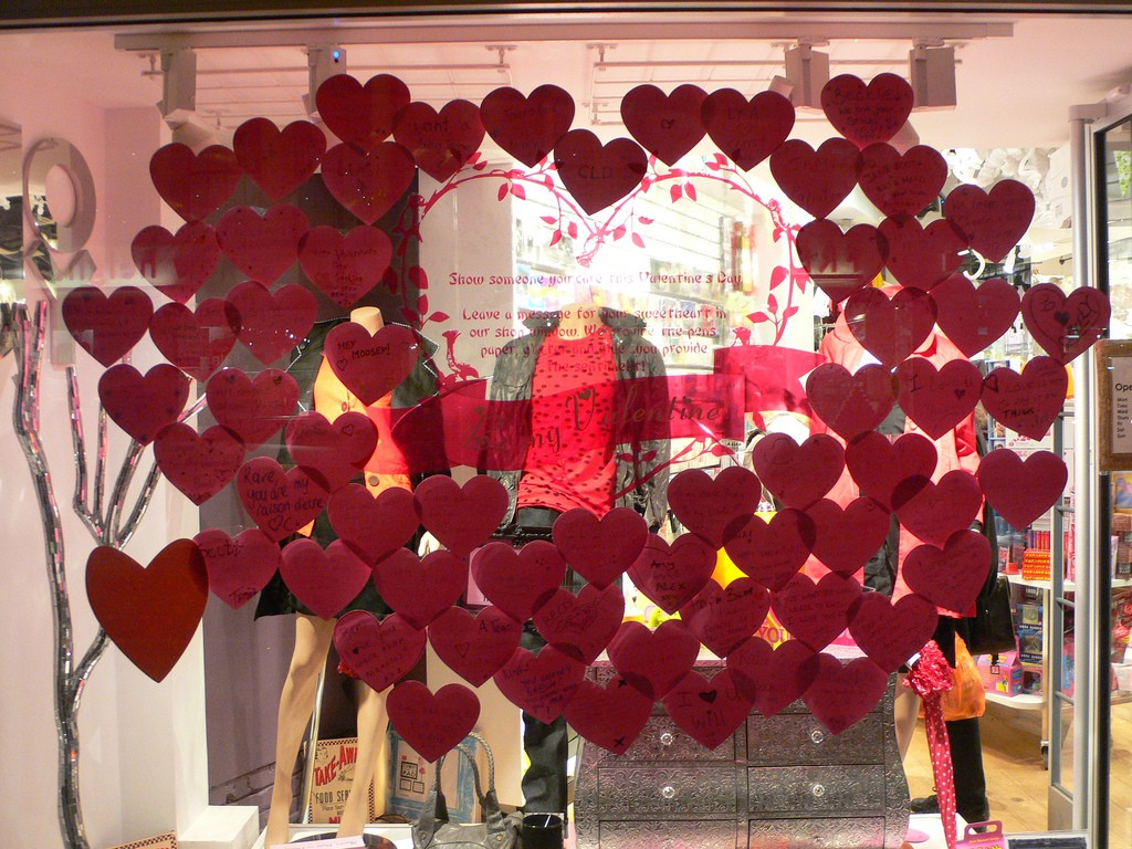 Many paper hearts stick on the window display, sending love messages for Valentine's day.