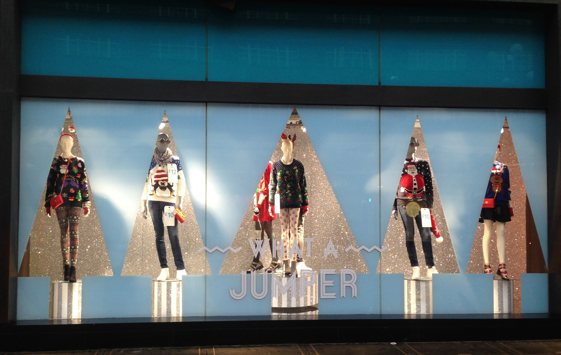 Primark wanted something with a focus on the outfit, so they had chosen rotating plinths and silvery shape of firs as a Christmas window display.