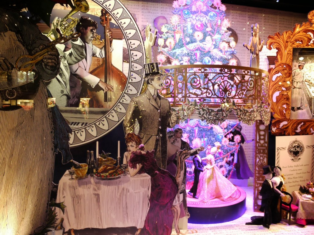 Many scenes are happening in this New Year's Eve window display, with dancing people, musicians, and other fitting details.