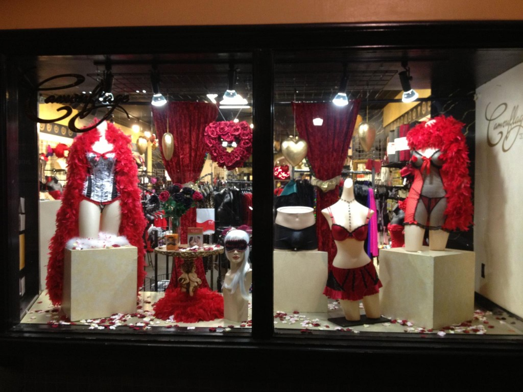 A romantic window display, for Valentine's day with red feathers and red lingerie.