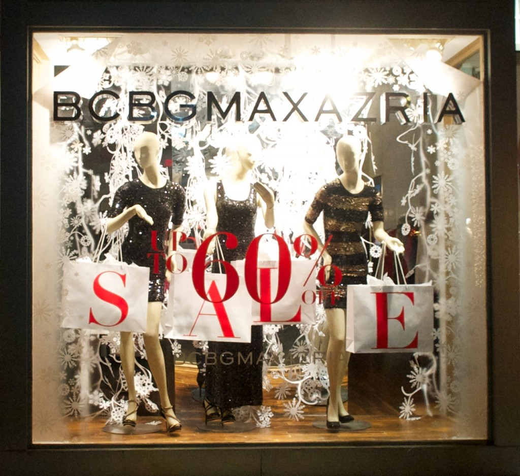 A full new year's window display with sparkling dresses, black & white background and sales.