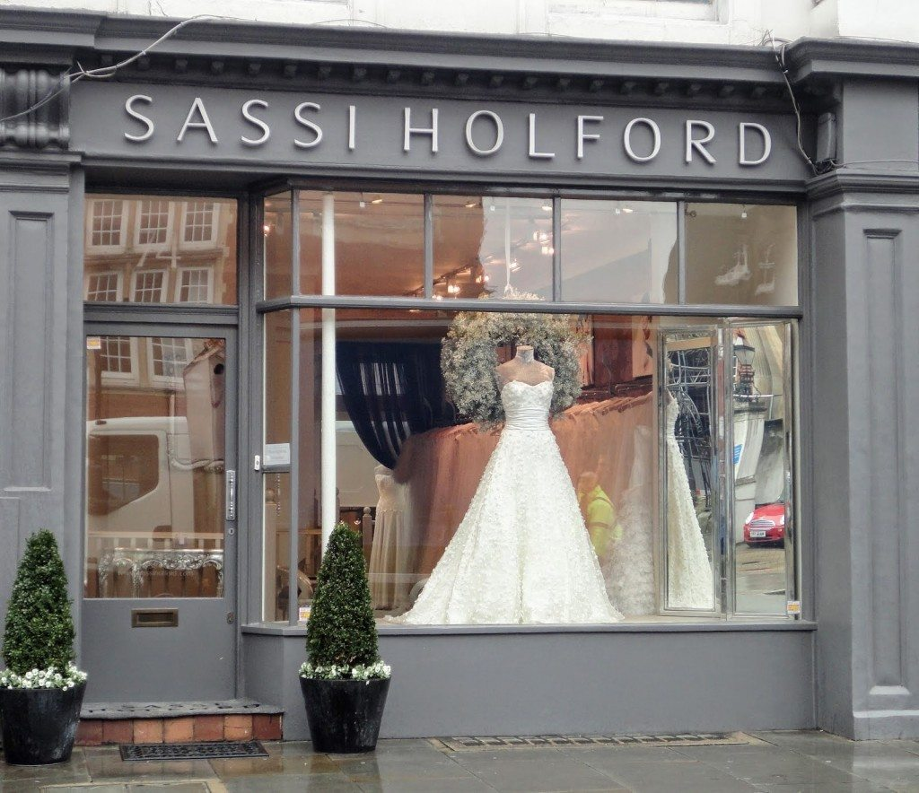 Sassi Holford decorated the window display with a simple and beautiful wedding dress and a Christmas wreath.