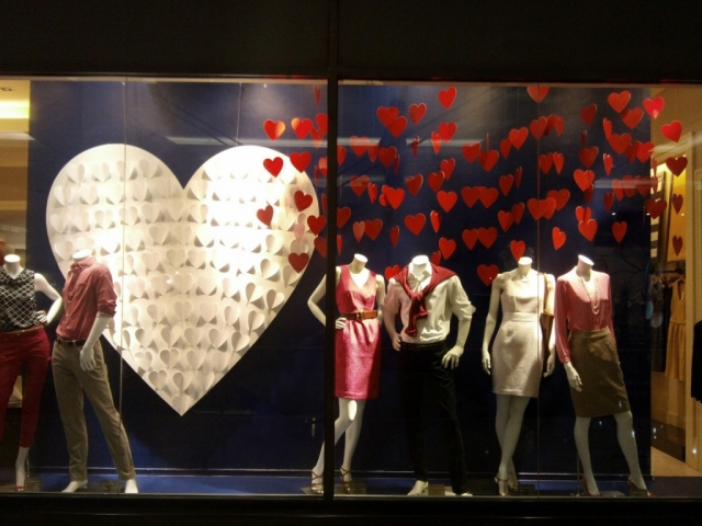 The Banana Republic has romantic red hearts in the window display and a big white heart in the background for Valentine's day.