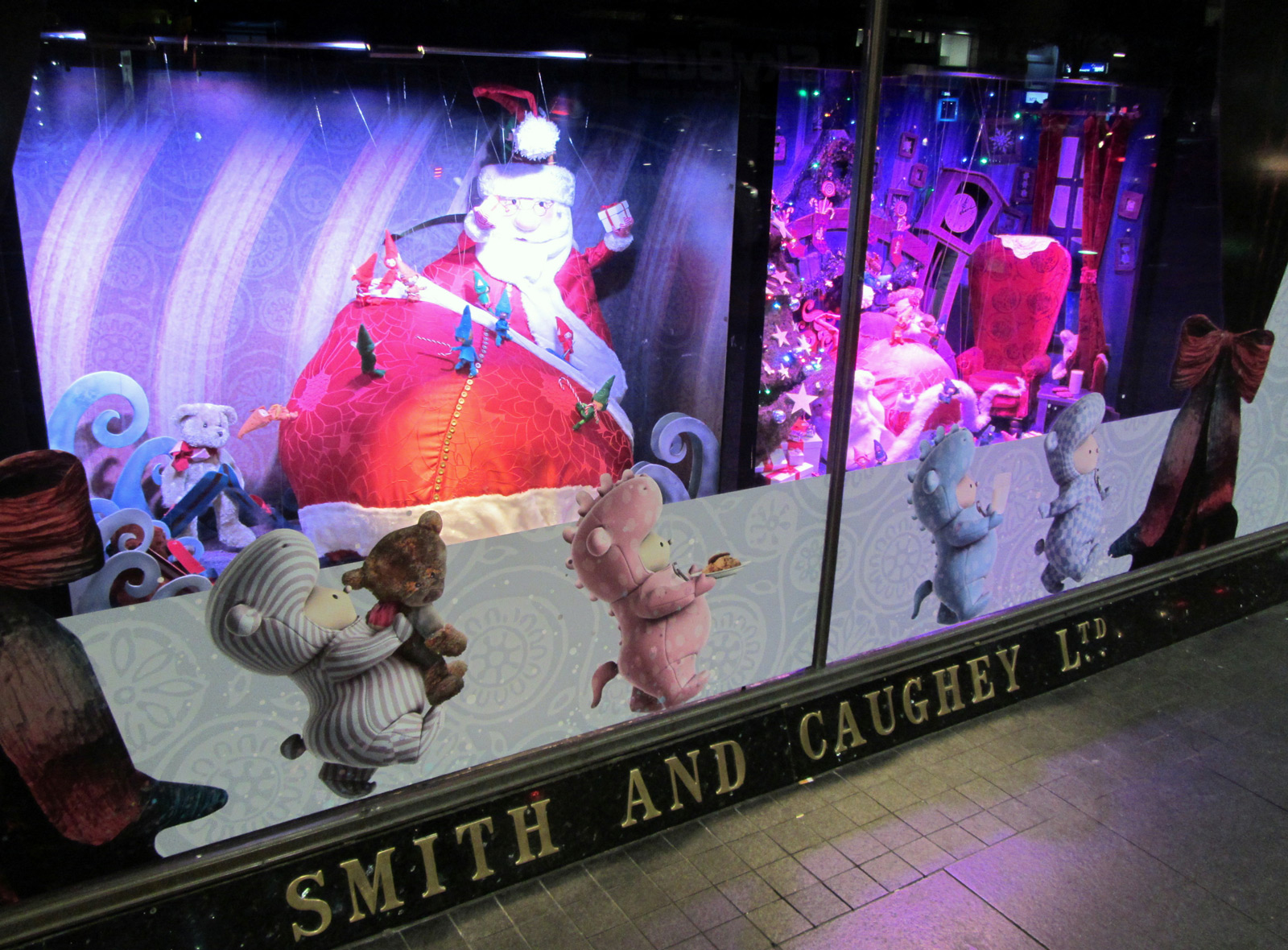 Cute stickers on the window display and Santa in the background to feel better the Christmas, at Smith and Caughey.
