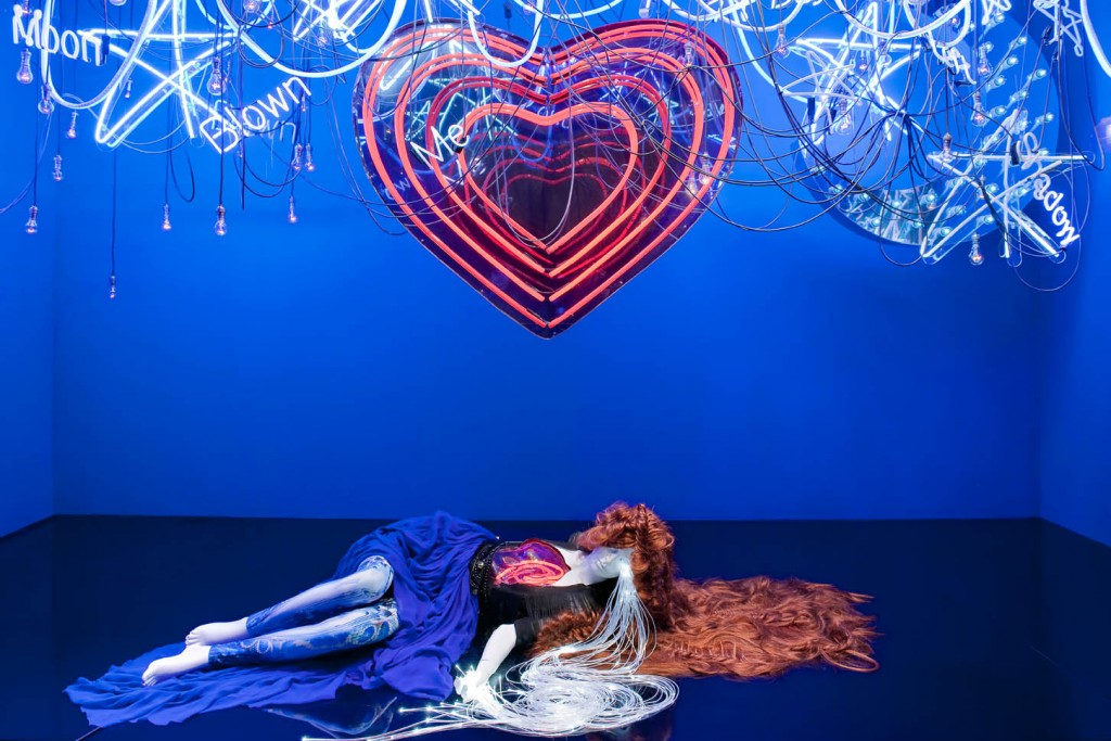 "Selfridges has blue lights for Valentine's day and a window display decorated unusual. We can see a mannequin laying on the floor. The theme could be ""Fallen in love""."