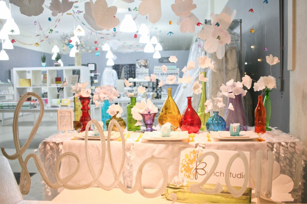 This 2011 New Year's Eve window display was welcomed with white decor and colored glass recipients.