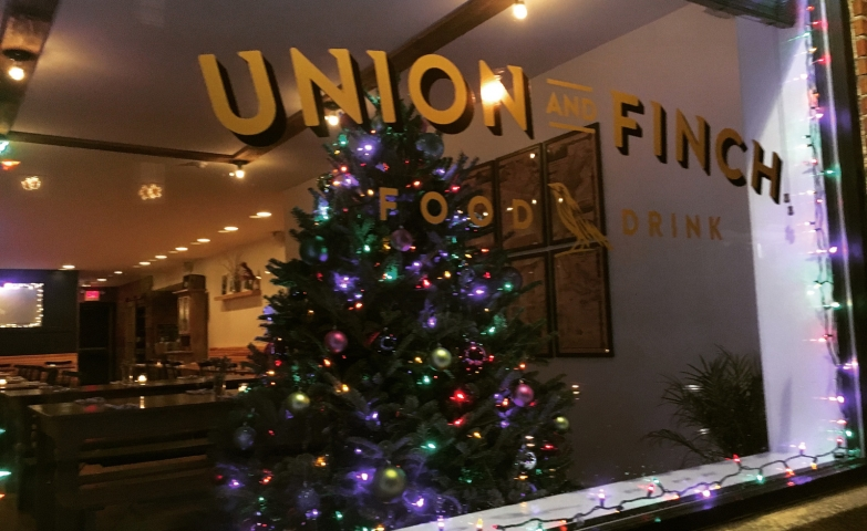 Union and Finch have a rich decorated fir placed in the Christmas window display, with lights that are also added to the outside of the window.