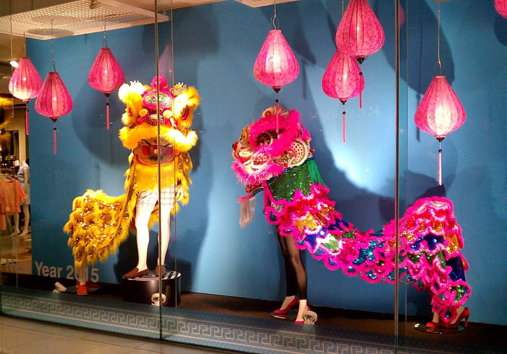 At Zen department store, in Bangkok, the window display is ready for the New Year's Eve with pink and yellow dragon costumes, and pink lights.