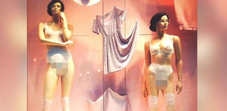 Fresh and clean this Valentine's day window display with white lingerie and a pink pastel color on the background.
