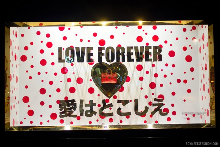 "Japan-style with white background and red spots as a background for this window display, but also a heart in the middle and a message with ""Love forever"" as it's Valentine's day."