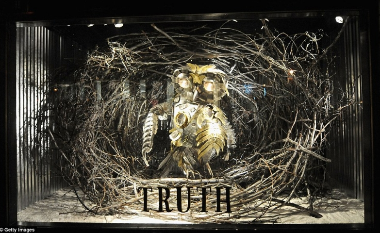 """Barney's has a theme called """"Truth"""" and inside this Christmas window display is a mechanical steampunk owl."""
