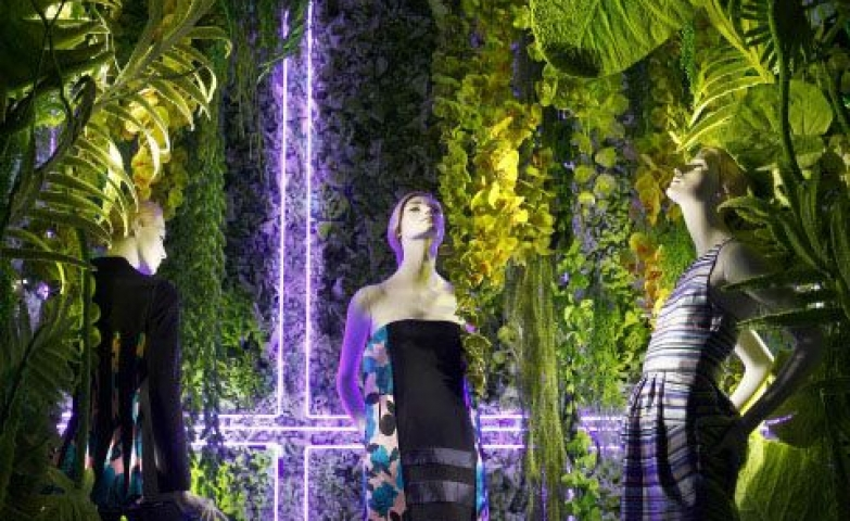 Dior window display with lots of plants and neon lights seen in New York, March 2014.