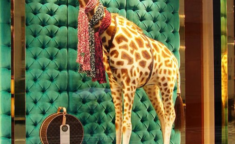 """Louis Vuitton came up with this """"fabtastic"""" concept to advertise their animal print scarves."""