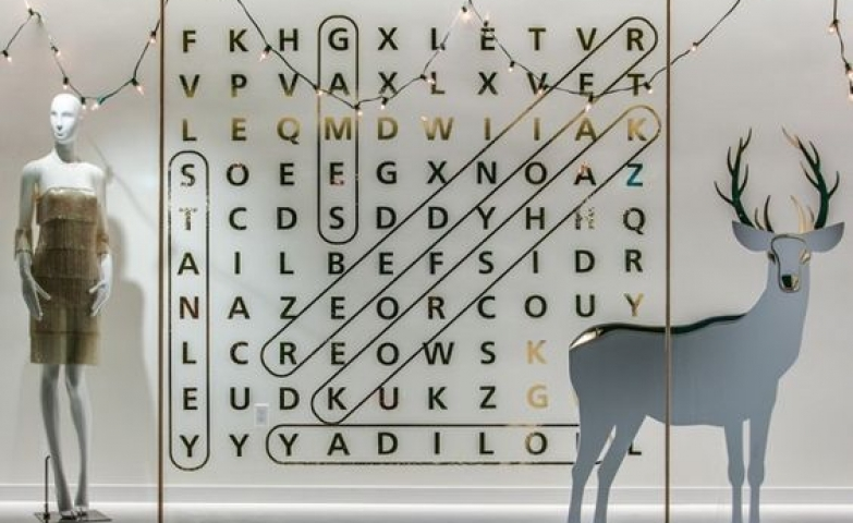 Front display made with a creative word puzzle and a festive reindeer. By Stanley Korshak in Dallas, Texas.
