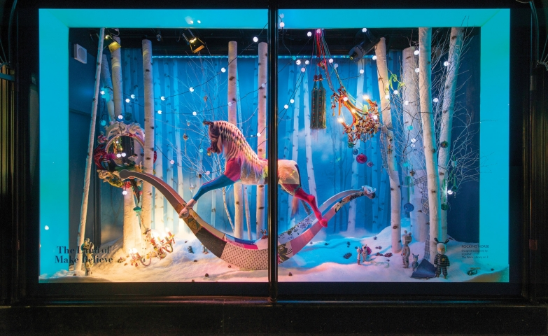For this window display, we have a carousel horse surrounded by lights and placed on a woods background.