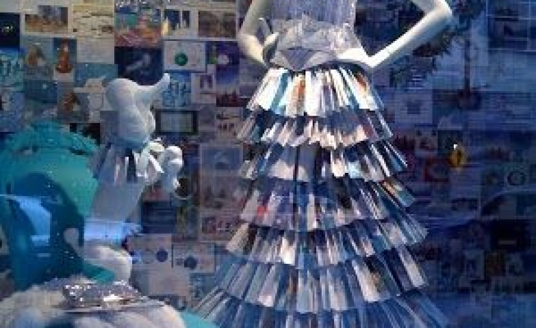 The center piece of this window display is a unique dress made out of Christmas greeting cards. Seen at Neiman Marcus in Dallas.