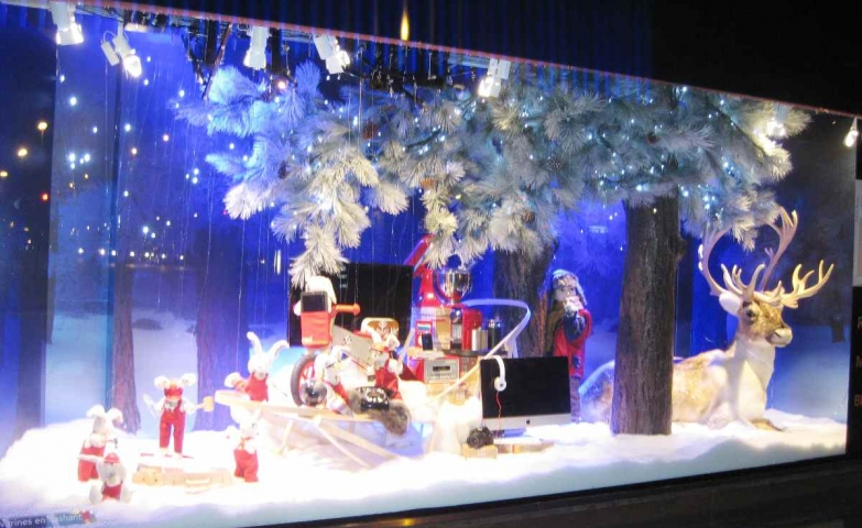The deer is in the guard for all these gifts from the Christmas window display, made by the Santa's helpmates.
